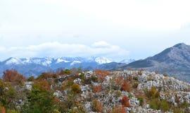 First snow in Montenegro`s mountains. View from Dalmatia Mountains to Montenegro stock photos