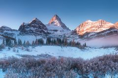Free First Snow. Mount Assiniboine, Also Known As Assiniboine Mountain, Is A Pyramidal Peak Mountain Located On The Great Divide. Royalty Free Stock Photos - 141248018