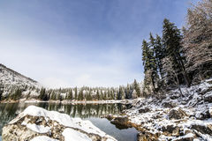 First snow at the mountain lake Stock Image