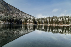 First snow at the mountain lake Royalty Free Stock Images