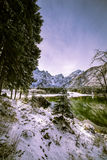 First snow at the mountain lake Stock Images