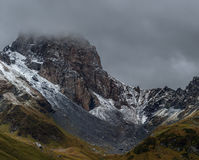 First snow on the mountain pass Zagedan. Caucasus mountains. Stock Images