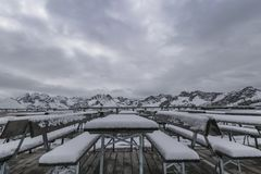First snow in the mountains. First snow on the panoramic terrace in the midst of the mountains Stock Image
