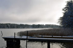 First snow on pier. Royalty Free Stock Photography