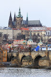 First Snow in Prague, snowy gothic Castle with the Charles Bridge, Czech Republic Stock Image