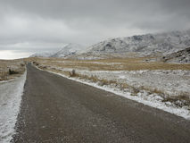 First snow on the road Stock Image