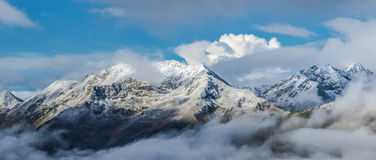 First snow at tops of mountains. Dawn. Mount Mamkhurts. Royalty Free Stock Photo