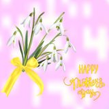 The first snowdrops Galanthus with Happy Mother s Day gift card. Stock Images