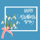 The first snowdrops Galanthus with Happy Mother s Day gift card. Stock Image