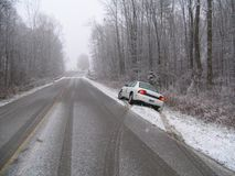 First Snowfall. A white car that has slid into the ditch on the first snowfall of the year Stock Photography