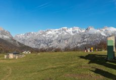 The first snows of the year!. The first snows of the year in the Picos de Europa mountains, serves as a spectacular backdrop for lunch on a cold but radiant day Royalty Free Stock Images