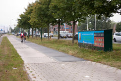 First solar cycle lane in the world. KROMMENIE - SEPTEMBER 17: First solar cycle lane in the world, created by SolaRoad company. Generates electric energy to stock images