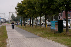 First solar cycle lane in the world. KROMMENIE - SEPTEMBER 17: First solar cycle lane in the world, created by SolaRoad company. Generates electric energy to royalty free stock photo