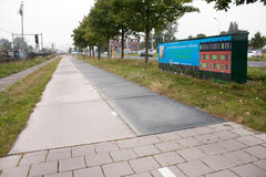 First solar cycle lane in the world. KROMMENIE - SEPTEMBER 17: First solar cycle lane in the world, created by SolaRoad company. Generates electric energy to royalty free stock image