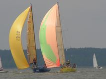 Dangerous convergence of yachts. Photo 2 of 14. The Minsk Sea Zaslavskoe reservoir Republic of Belarus. The first stage of the open Cup `Belarusian Sailing stock photo