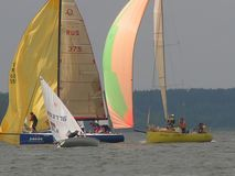 Dangerous convergence of yachts. Photo 3 of 14. The Minsk Sea Zaslavskoe reservoir Republic of Belarus. The first stage of the open Cup `Belarusian Sailing royalty free stock images