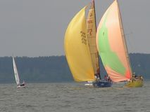 Dangerous convergence of yachts. Photo 1 of 14. The Minsk Sea Zaslavskoe reservoir Republic of Belarus. The first stage of the open Cup `Belarusian Sailing royalty free stock photos
