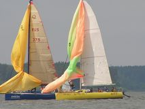 Dangerous convergence of yachts. Photo 4 of 14. The Minsk Sea Zaslavskoe reservoir Republic of Belarus. The first stage of the open Cup `Belarusian Sailing stock photography