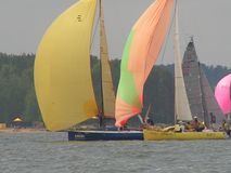Dangerous convergence of yachts. Photo 9 of 14. The Minsk Sea Zaslavskoe reservoir Republic of Belarus. The first stage of the open Cup `Belarusian Sailing stock photos