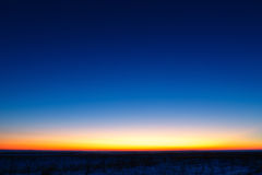 First stars in the background of a bright sunset. Royalty Free Stock Image