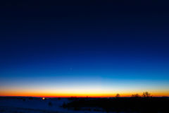 First stars in the background of a bright sunset. Royalty Free Stock Images