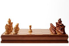 First step. First chess move on a wood chessboard Stock Photos