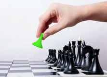 First step. Man makes first step in chess Stock Photo