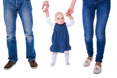 First step concept - young parents with baby girl learning to wa Stock Image