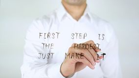 First Step is the Hardest, Just Make it, Man Writing on Glass. High quality Royalty Free Stock Image