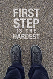 First Step is the Hardest. Motivational Message on Street Pavement Royalty Free Stock Photos