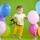 First steps. Cute baby making first steps over green Royalty Free Stock Photos