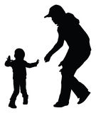 First steps. Silhouettes of mother and toddler learning to walk. Vector eps8 Royalty Free Stock Photography