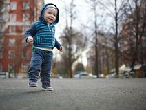 First steps. The first independent steps of the kid. Natural colors, shallow dof Stock Images