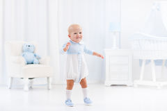 First steps of baby boy learning to walk Royalty Free Stock Photography