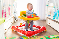 First steps in a baby walker Stock Photo