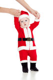 First steps of child baby dressed as Santa claus Royalty Free Stock Image