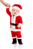 First steps of cute baby boy Santa Claus  Stock Photos