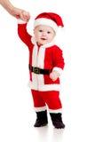 First steps of cute baby boy Santa Claus  Stock Photos