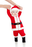 First steps of funny Santa claus baby boy Royalty Free Stock Photo