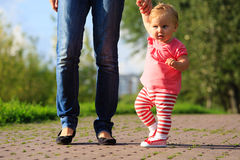 First steps of little girl in park Royalty Free Stock Images