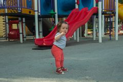 First steps of little girl on summer playground, The first independent steps royalty free stock image