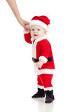 First steps of Santa Claus baby boy. Studio shot Stock Photography