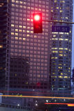 First Street Red. Office buildings at dusk. First Street and blurred cars in the foreground. THis could be any city in any english speaking country in the world stock images