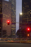 First Street Red Lights. Office buildings at dusk. First Street and blurred cars in the foreground. This could be any city in any english speaking country in the royalty free stock photography