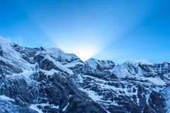 First sun rays behind Grand Barrier in Himalayas. Royalty Free Stock Image