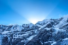 First sun rays behind Grand Barrier in Himalayas. First sun rays behind Grand Barrier in Himalayas, Annapurna Range, Nepal. Snowy himalayas mountains sunrise Stock Images