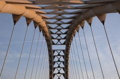 First sunlight defining Humber Bay Arch Bridge. Dawn rays catch Thunderbird motif in patterns of Humber Bay Arch Bridge spring morning Royalty Free Stock Photos