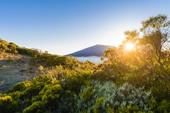 First sunlights of the day over Dolomieu crater at Reunion Islan Stock Photo