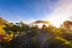 First sunlights of the day over Dolomieu crater at Reunion Islan Stock Photography