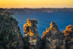 First sunrays in the morning at Three Sisters in Blue Mountain. Three Sisters close up at sunrise - View from Ecco Point, katoomba, Blue Mountains National Park royalty free stock photo